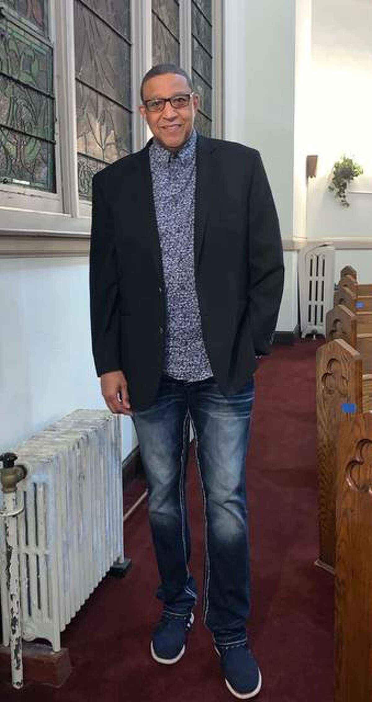Alton's incoming mayor David Goins is as comfortable working in jeans within his church as he was meeting with community members as an Alton school board member.