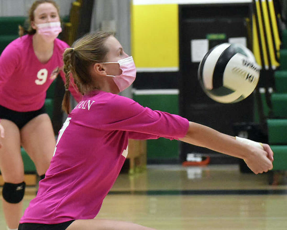 Metro-East Lutheran's Morgan Ashauer successfully receives a serve against Bunker Hill in the second game on Tuesday in Edwardsville.