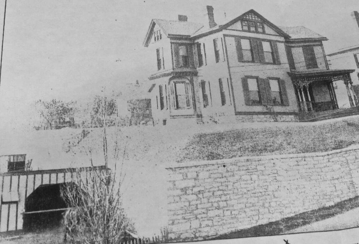A photo from the early 20th century shows the property featuring what appears to be horse stables. Beth Machens believes the adjacent tunnels were used for underground referidgeration.