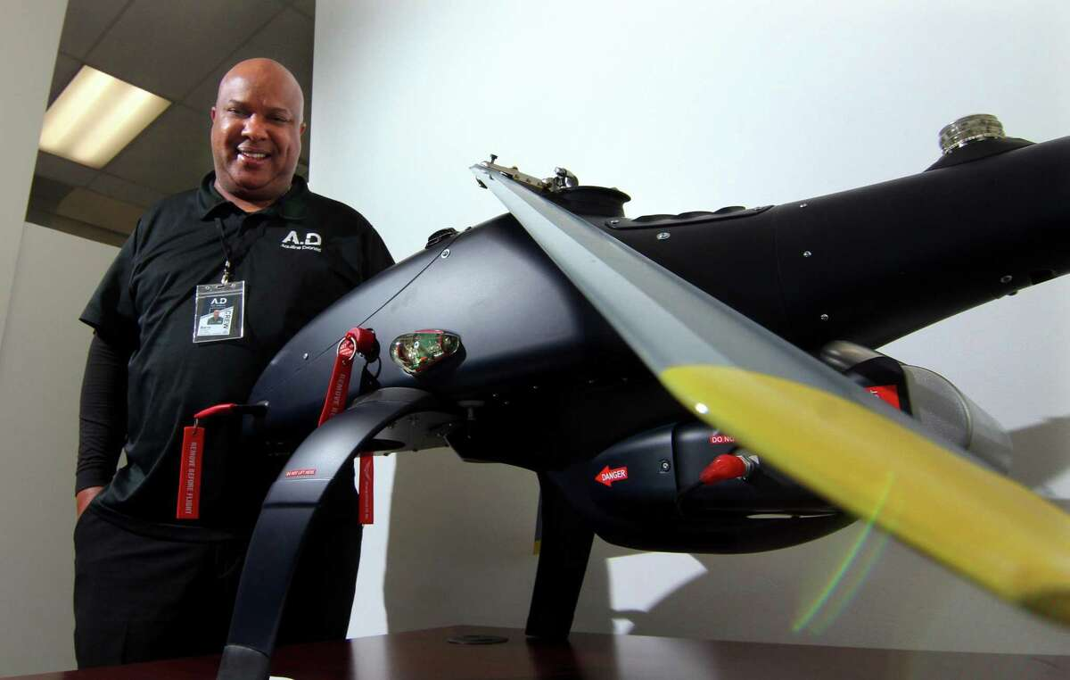 Aquiline Drones founder and CEO Barry Alexander poses with a prototype displayed at the company's headquarters in the Stark Building at 750 Main St., in downtown Hartford, Conn., on Tuesday, March 30, 2021.