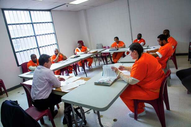 Students in Georgetown University's Prison Scholars Program study with professor Marc Howard at the D.C. Jail in fall 2018. The program will be expanded to offer bachelor's degrees to inmates in Maryland's state prison system this fall.
