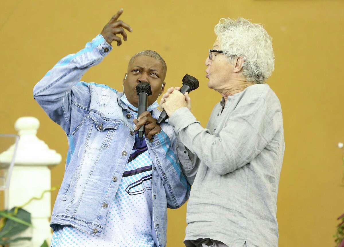"""Kevin Cronin, lead singer of REO Speedwagon, and LaTonya Floyd, sister of George Floyd, sing """"Keep on Loving You"""" together at The Community of Faith Church in Houston for a prayer vigil for the family on Friday, April 9, 2021. Cronin read in People Magazine about the last time George and LaTonya talked on the phone and how they sang that song to each other. It was a song they had been sharing together over the years."""