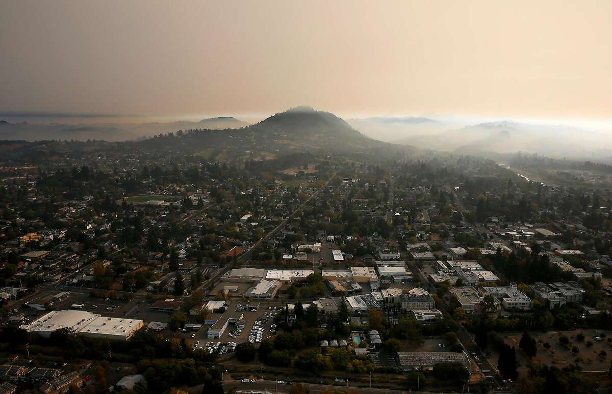 A thick layer of smoke hovers over Healdsburg as the Kincade Fire continues to burn in Sonoma County on Tuesday, Oct. 29, 2019.