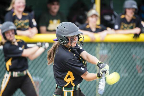 Dow High's Taylor Huschke makes contact during a May 16, 2019 game against Midland High.