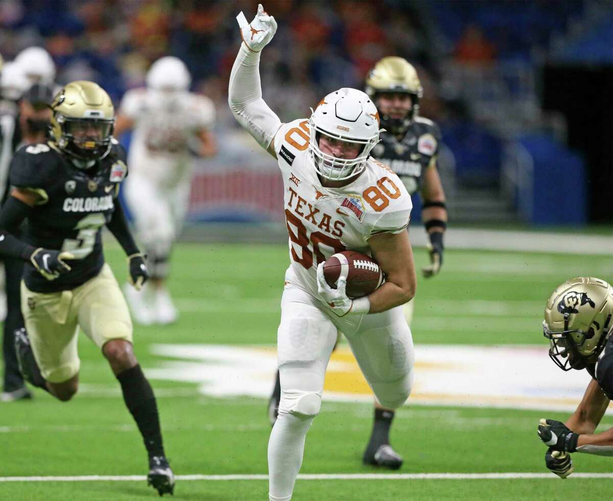 Longhorn tight end Cade Brewer recovers his balance after a catch downfield as Texas plays Colorado in the Alamo Bowl at the Alamodome on Dec. 29, 2020.