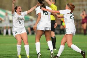 Players celebrate Siena's Jayanna Monds', center, score against Iona during a Metro Atlantic Athletic Conference Tournament quarterfinal soccer game on Thursday, April 8, 2021 in Loudonville, N.Y. (Lori Van Buren/Times Union)
