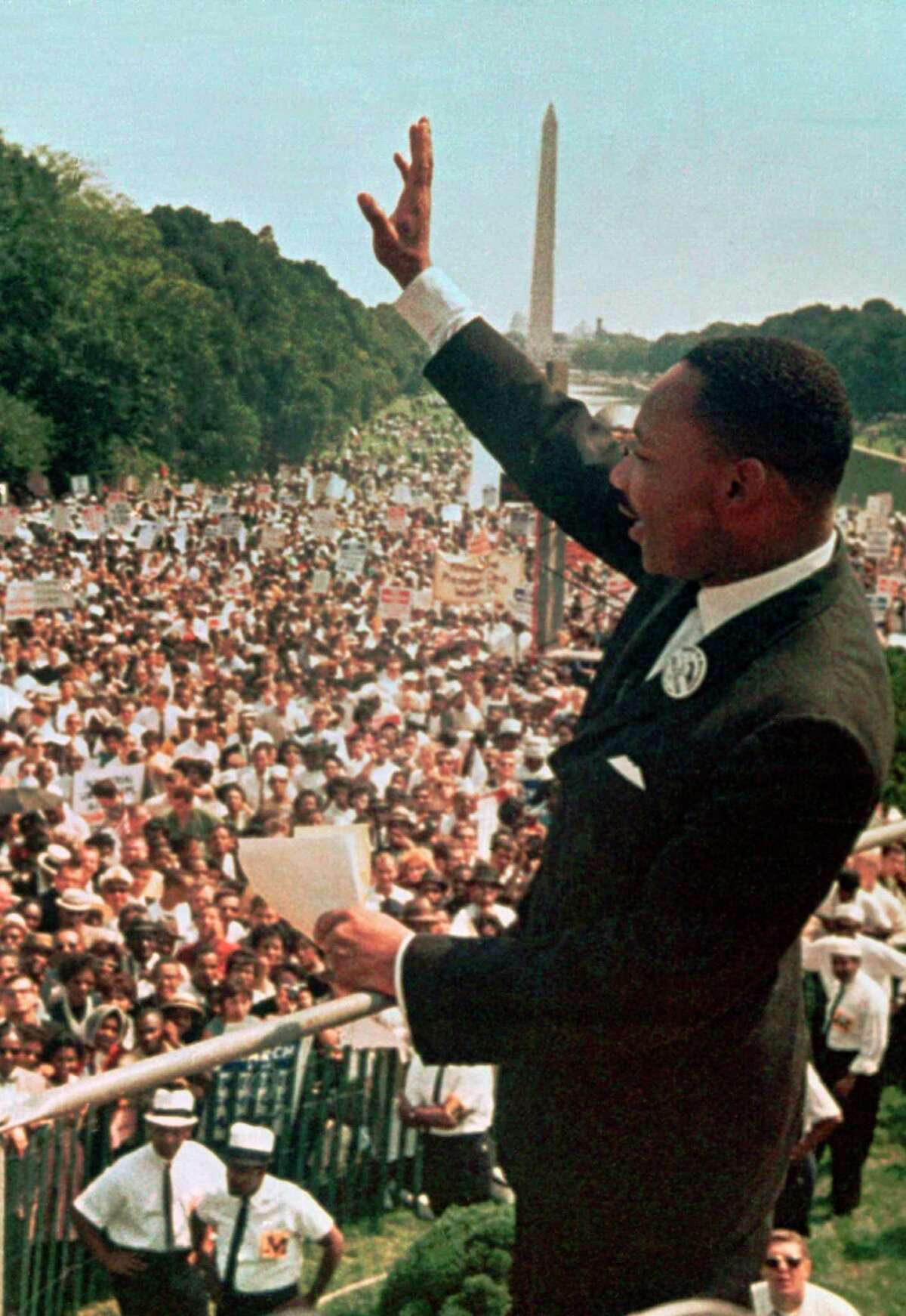 """Martin Luther King Jr. acknowledges the crowd at the Lincoln Memorial for his """"I Have a Dream"""" speech in 1963, presaging the Civil Rights Act and Voting Rights Act."""