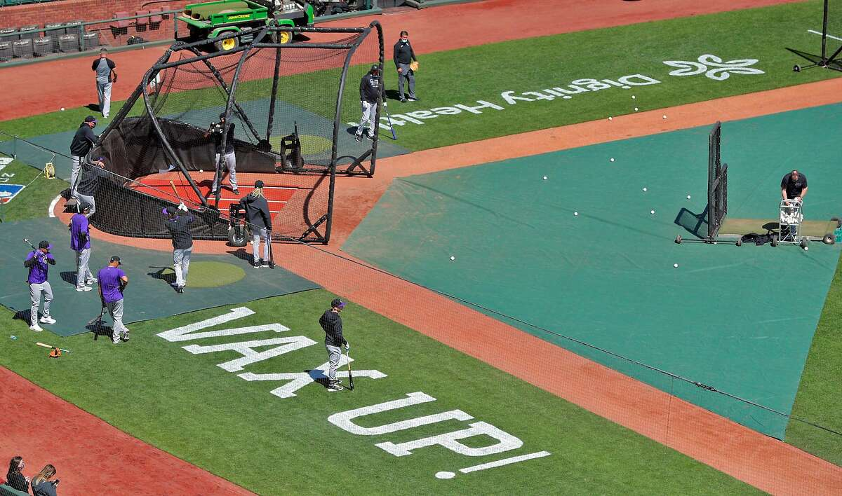 A message about vaccinations is printed on the field as the Rockies take batting practice before the San Francisco Giants played the Colorado Rockies at Oracle Park in San Francisco Calif., on Friday, April 9, 2021.