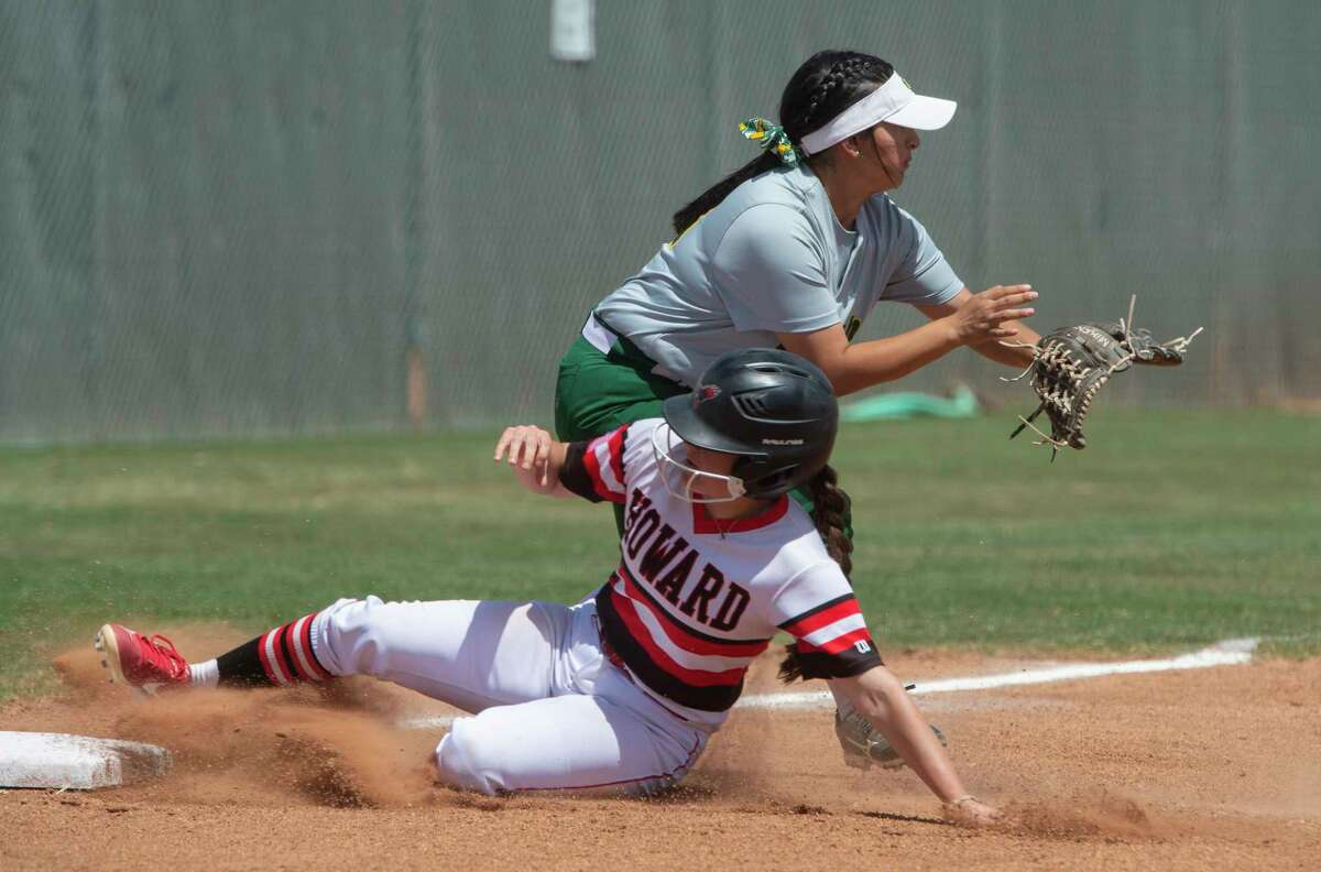 Howard College's Macey Meraz safely slides into third as Midl;and College's Aliyah Lara waits for the throw 04/09/21 at Midland College softball field. Tim Fischer/Reporter-Telegram