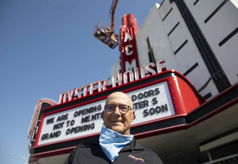 Sign technician Mark Klaybor poses for a photograph in front of the new ACME Oyster House Thursday, April 1, 2021, in Houston. Klaybor lived in Houston in the late 70s into the early 80s when the building was the original Tower Theatre and had memories of watching shows at the theater. He said he was excited to come back to Houston to work on a buildling that he used to know. Photo: Yi-Chin Lee/Staff Photographer / © 2021 Houston Chronicle