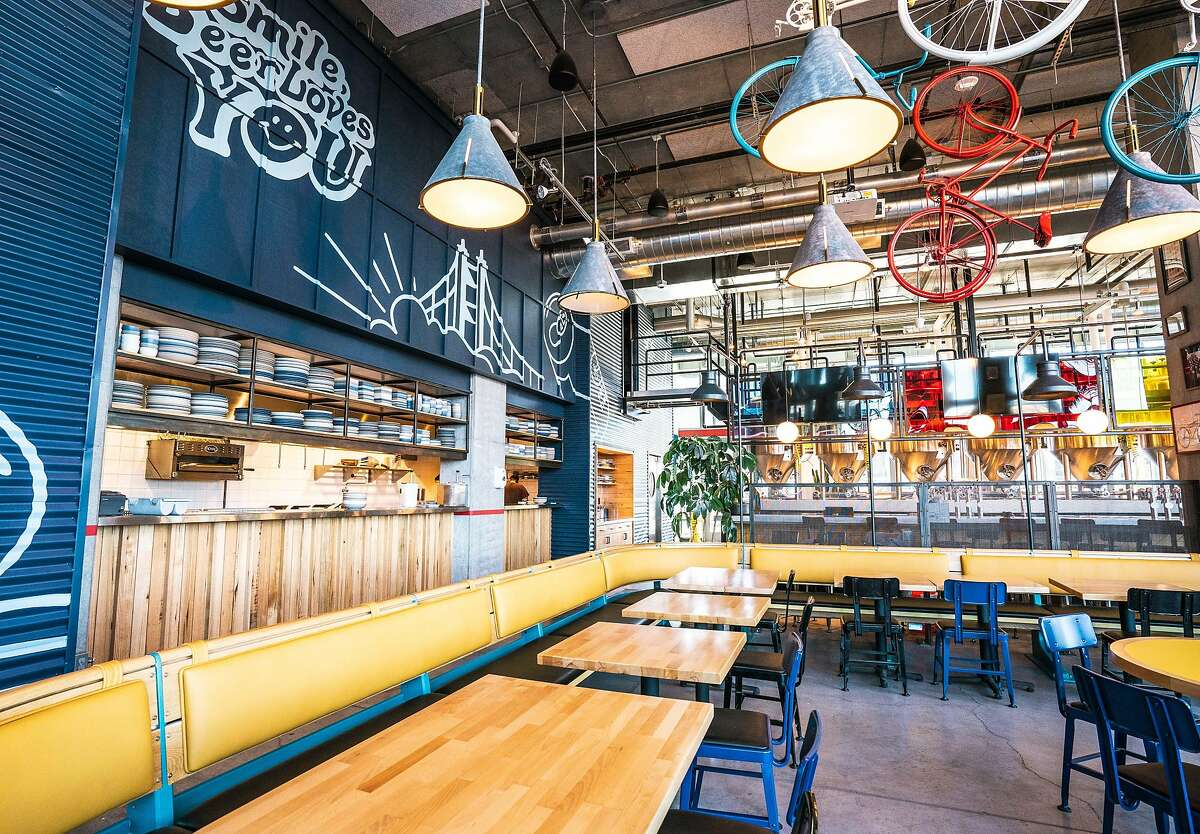 New Belgium Brewing's restaurant is filled with bicycle decor, a nod to the company's logo.
