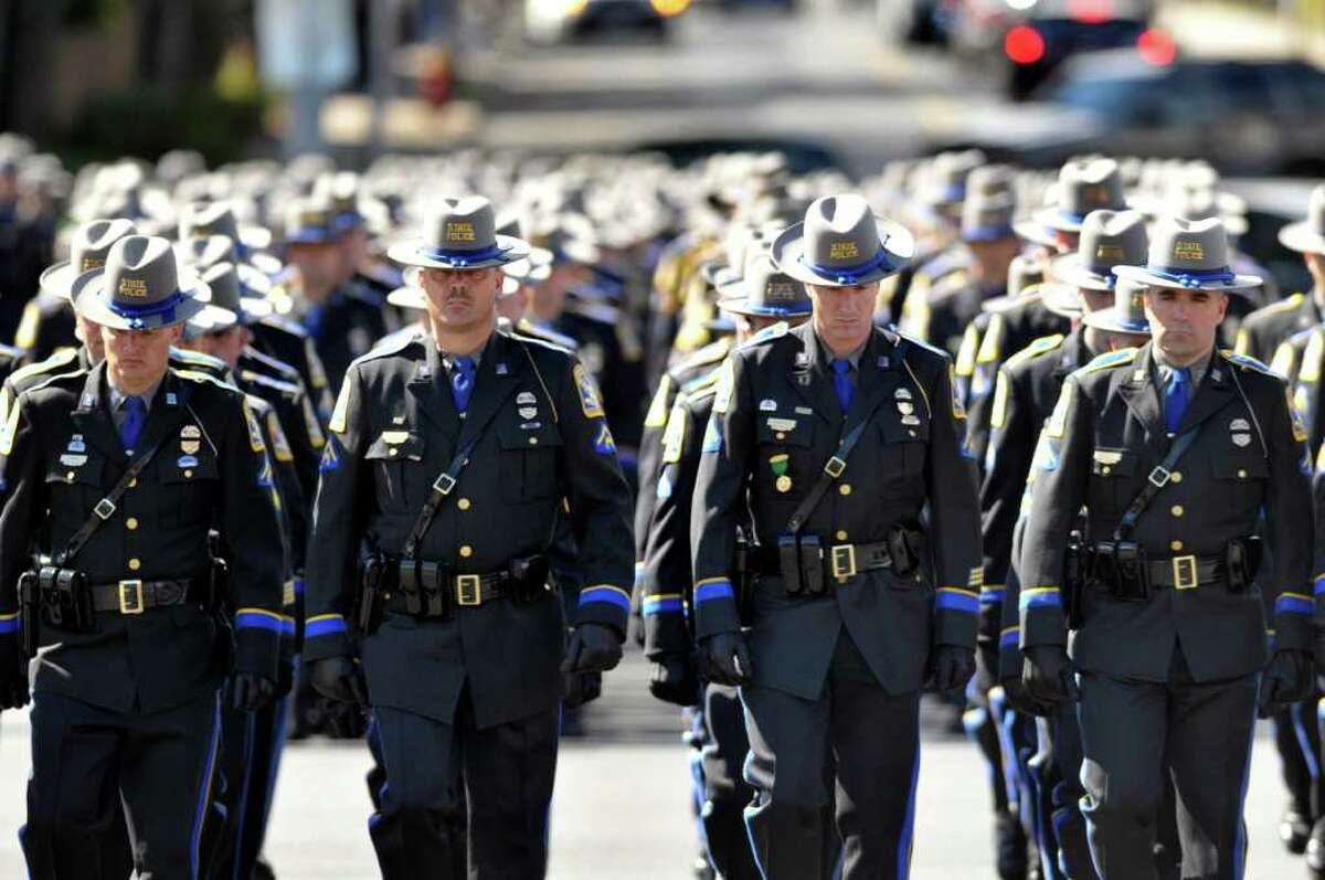 Connecticut State Troopers march Friday, Sept. 10, 2010 toward the State Armory for the funeral of Trooper Kenneth Hall, who died when a pick-up truck crashed into his patrol car during a traffic stop last week on I-91. (AP Photo/Hartford Courant, Rich Messina)