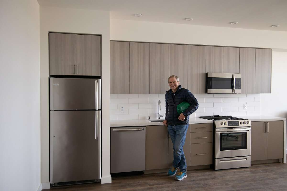 Rick Holliday, CEO of Factory OS, stands in a modular apartment that was built indoors and brought to the building site next to El Cerrito del Norte BART Station.