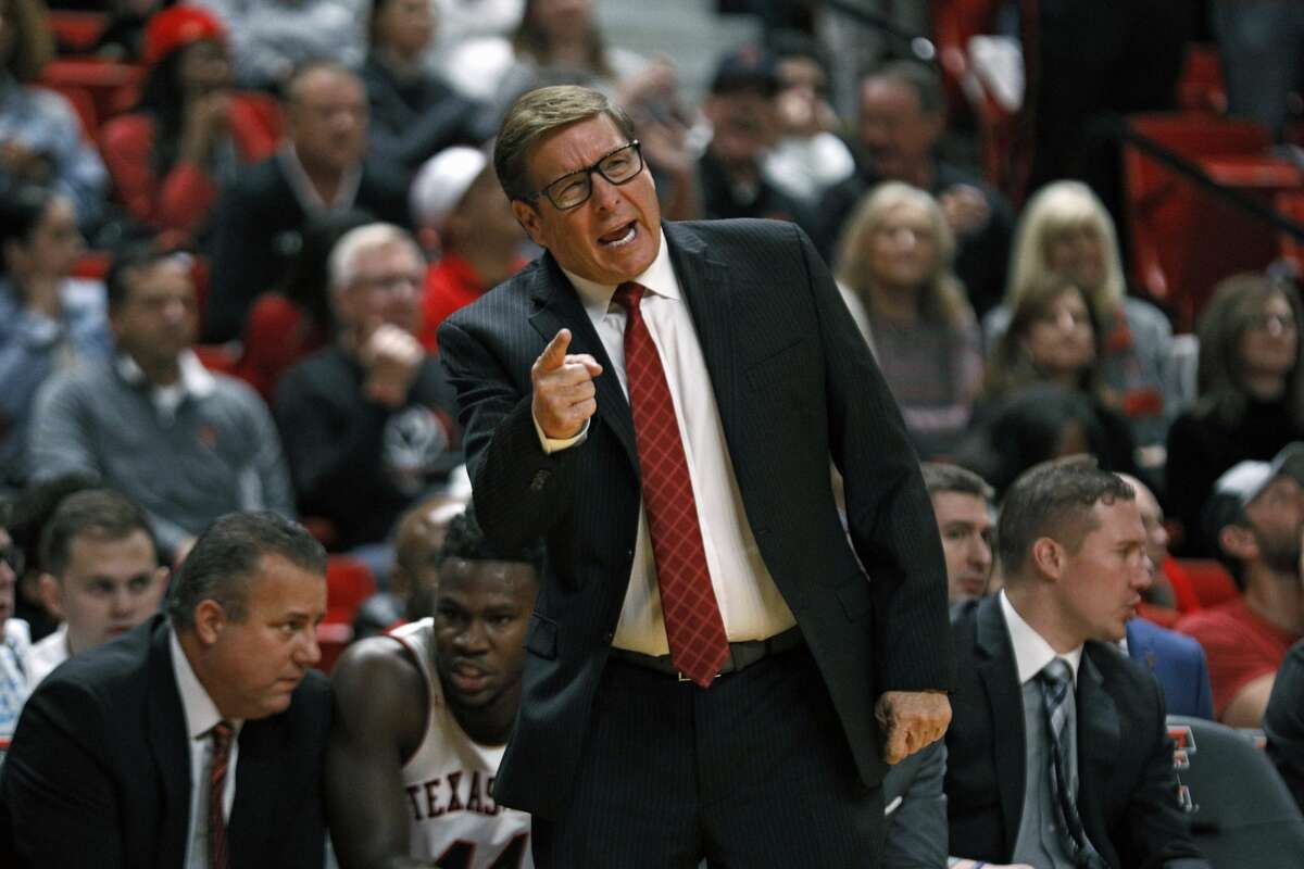 """FILE - In this Thursday, Nov. 21, 2019 file photo, Texas Tech assistant coach Mark Adams yells out to the players during the first half of an NCAA college basketball game against Tennessee State in Lubbock, Texas. Texas Tech is promoting top assistant and school alumnus Mark Adams to replace Chris Beard as head coach. Kirby Hocutt, Tech's athletic director, sent a tweet Monday night, April 5, 2021 with a picture of him with Adams that read: """"Red Raider Nation _ your Head Men's Basketball Coach, Mark Adams."""" (AP Photo/Brad Tollefson, File)"""