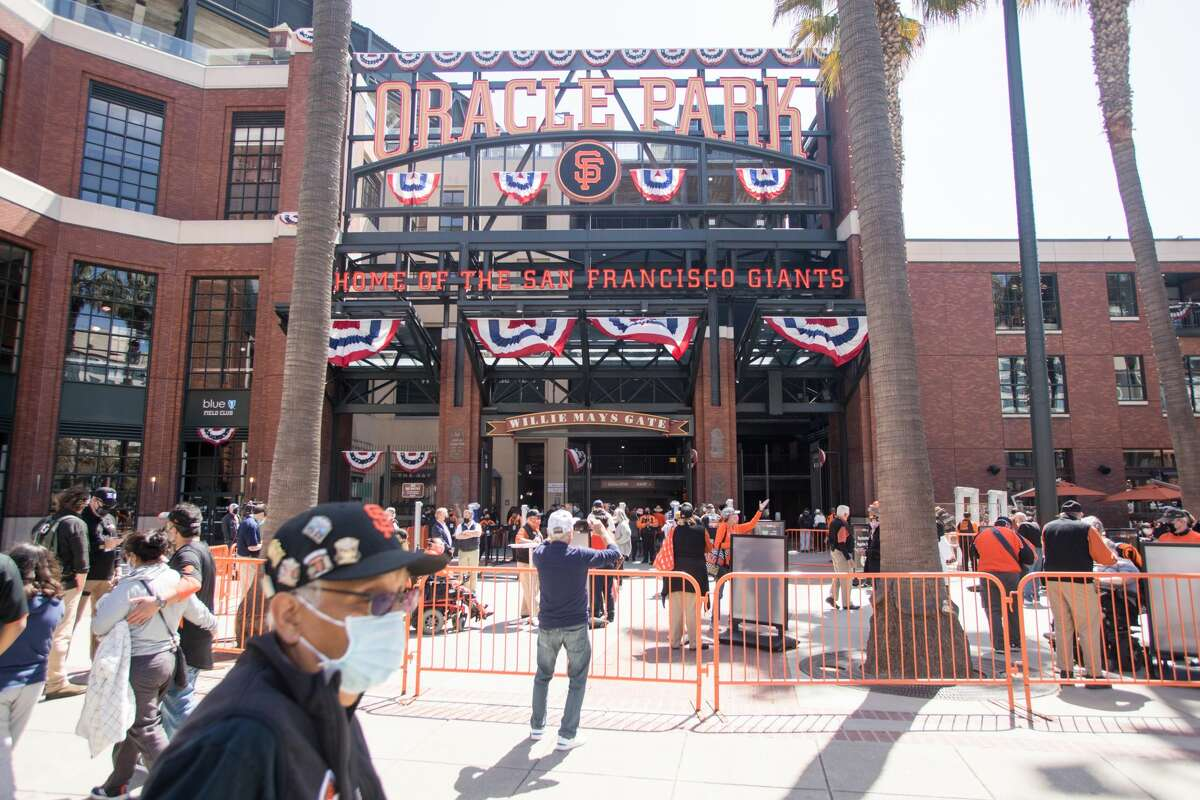 An area of Willie Mays Plaza was gated off to check the tickets and whether fans had received a COVID-19 vaccine or has a COVID-19 test before entering Oracle Park in San Francisco, California on April 9, 2021. The Giants held their home opener against the Colorado Rockies.