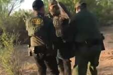 U.S. Border Patrol agents are seen carrying a woman out of the brush. She was determined to be an immigrant illegally present in the country who was suffering from severe dehydration.