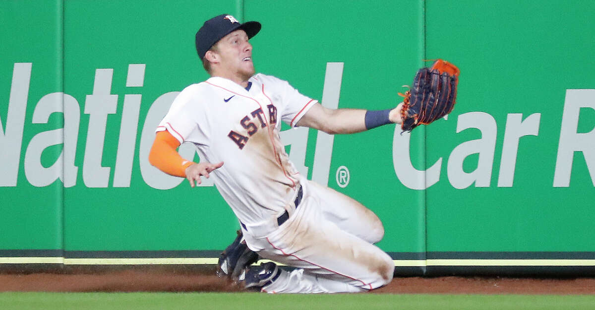 Houston Astros center fielder Myles Straw (3) catches Oakland Athletics shortstop Elvis Andrus'line drive during the ninth inning of the Astros home opener MLB baseball game at Minute Maid Park, in Houston, Thursday, April 8, 2021. Astros beat the Oakland Athletics 6-2.