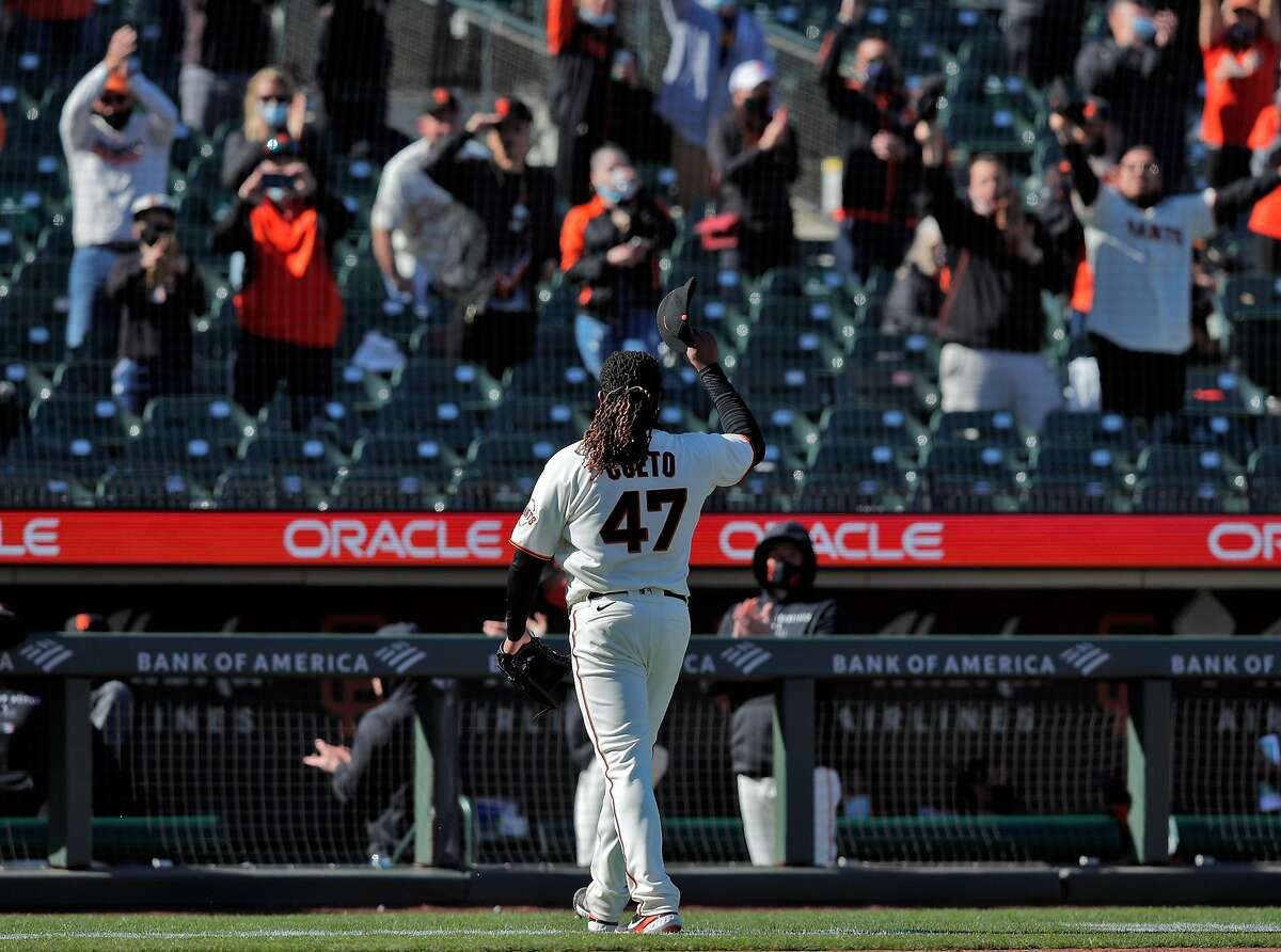 Johnny Cueto (47) tips his hat to the fans after being pulled in the ninth inning as the San Francisco Giants played the Colorado Rockies at Oracle Park in San Francisco Calif., on Friday, April 9, 2021.