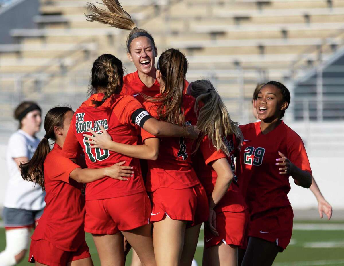 FILE PHOTO - The Woodlands midfielder Emily Bates (9) reacts with her teammates after Katherine Williams (3) scores a goal during the first half of a Region II-6A quarterfinals soccer match against Tomball at Woodforest Bank Stadium, Friday, April 2, 2021, in The Woodlands.