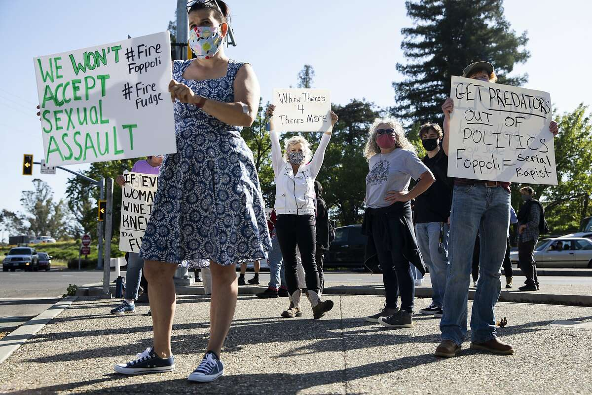 Sonoma County residents gathered on the corner of Lakewood Drive and Old Redwood Highway in Windsor on Friday to protest against Windsor Mayor Dominic Foppoli.