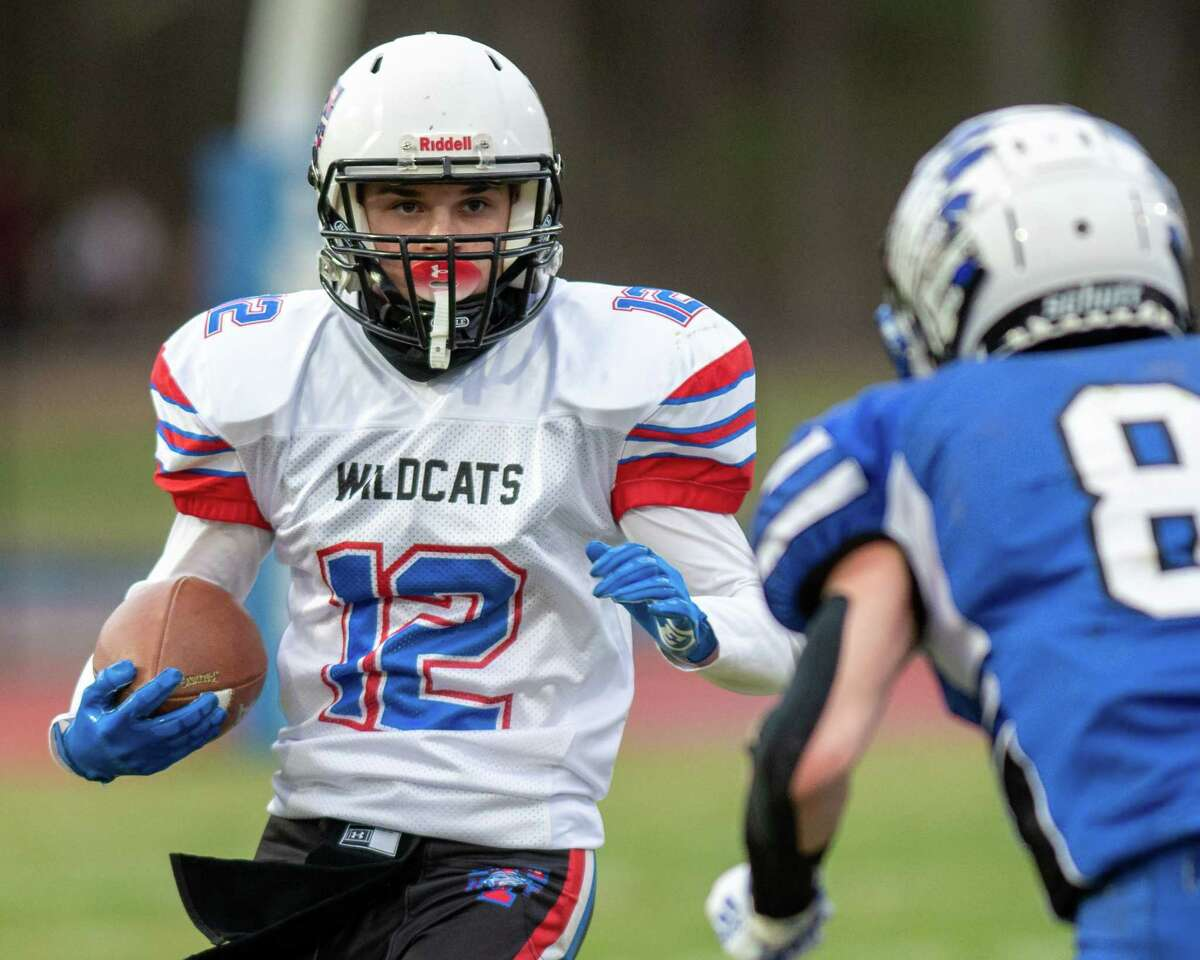 Hoosick Falls-Tamarac quarterback sophomore Michael Dagostino looks for running room in front of Coxsackie-Athens senior Brandon Wolbert during a game at Coxsackie-Athens High School in Coxsackie, NY, on Friday, April 9, 2021. (Jim Franco/Special to the Times Union)