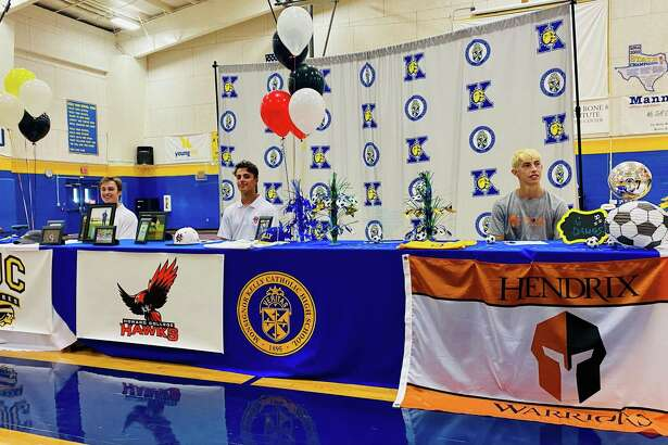 Three Kelly Catholic athletes signed with college teams Friday.