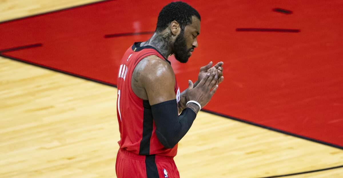 Houston Rockets guard John Wall (1) celebrates a Rockets rally during the third quarter of an NBA game between the Houston Rockets and Dallas Mavericks on Wednesday, April 7, 2021, at Toyota Center in Houston.