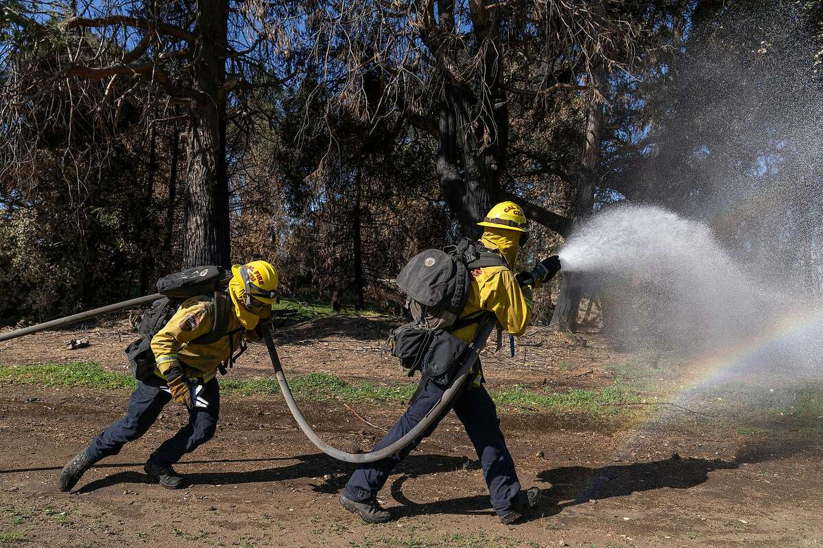 Cal Fire Santa Cruz and San Mateo Unit firefighters Donny Rippberger (left) and Ludovic Deshayes practice at the Cal Fire Ben Lomand Training Center in Santa Cruz.