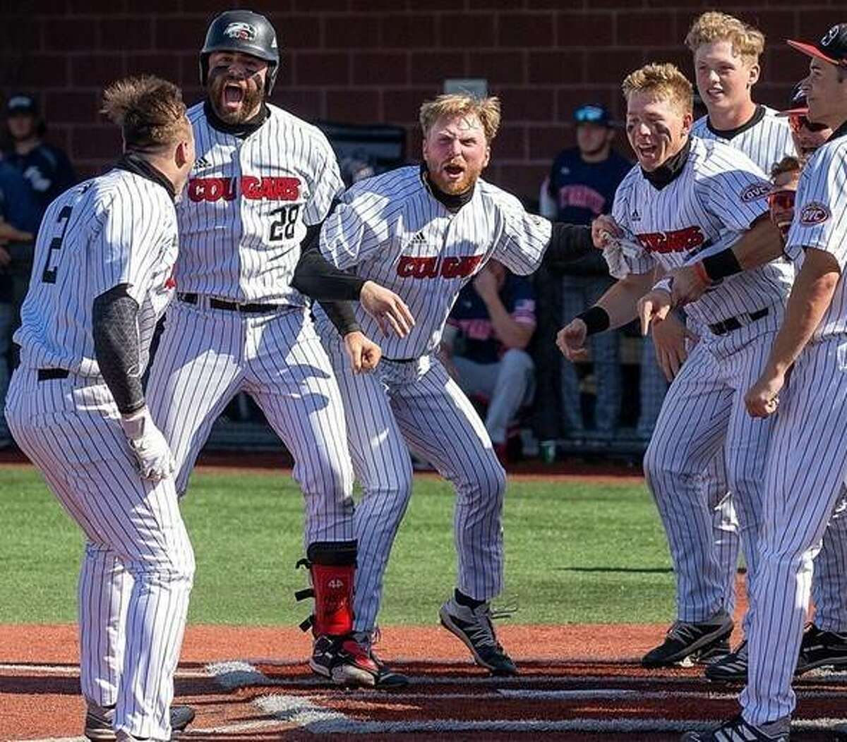 SIUE's Brady Bunten, center, gets set to touch home after his walk-off homer in the 10th inning of the first game of a doubleheader sweep of UT Martin Friday at SIUE.