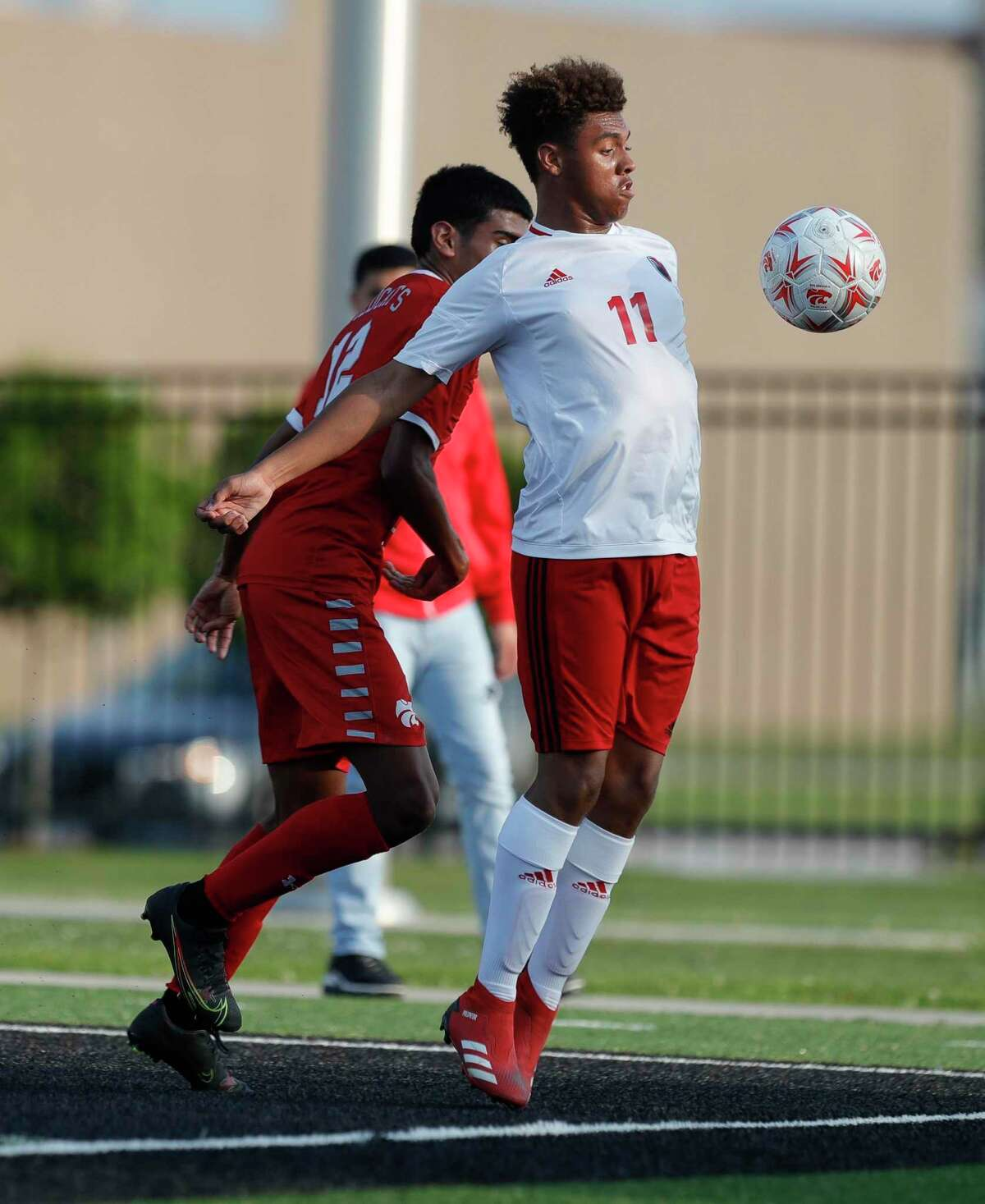 Huffman's Kenny Lane (11) controls the ball with his body during the first period of a Region III-4A championship match at Randall Reed Stadium, Friday, April 9, 2021, in New Caney.