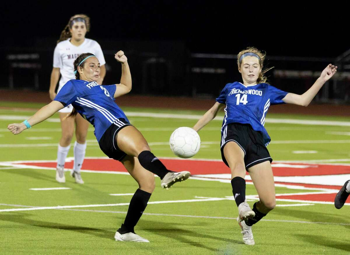 Friendswood Maya Palitz (22) and Brynn Farrar (14) both try to take control of the ball during the second half of the Region III-5A championship against Magnolia at Falcon Stadium, Friday, April 9, 2021, in Huffman.
