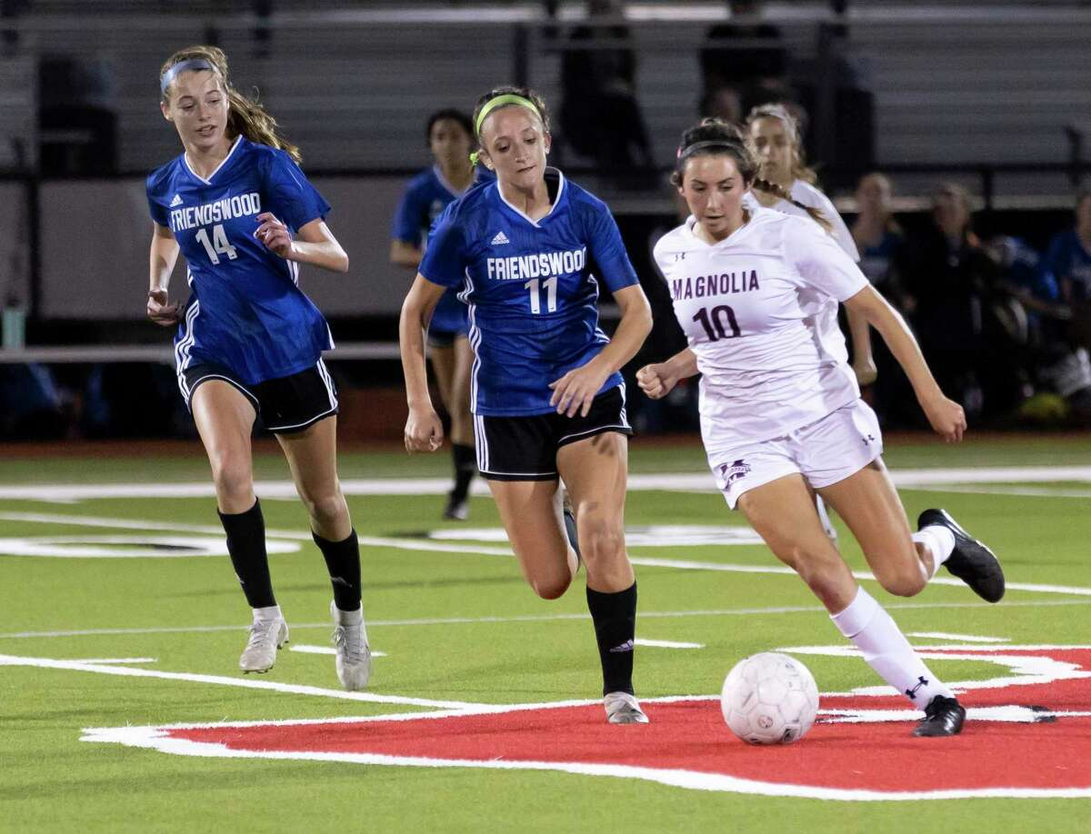 Friendswood's Cameryn Peter (11) is shown against Magnolia a playoff game last week. The Lady Mustangs couldn't come up with enough offense in a 1-0 Class 5A state semifinal loss to Dripping Springs Tuesday night in College Station.