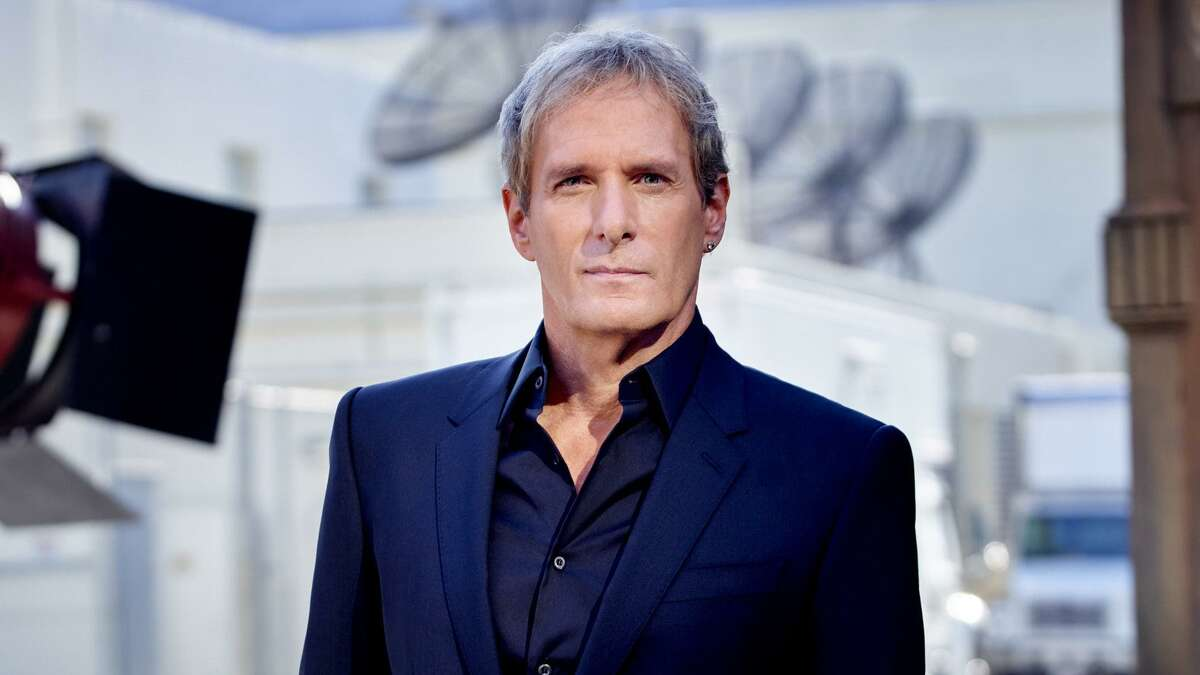 Michael Bolton will co-host 'The Celebrity Dating Game,' a reboot of the classic game show, with actress Zooey Deschanel.
