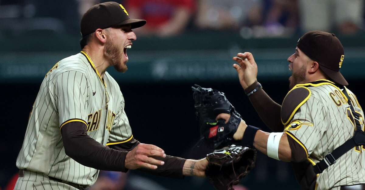 Joe Musgrove #44 of the San Diego Padres celebrates with Victor Caratini #17 after pitching a no-hitter against the Texas Rangers at Globe Life Field on April 09, 2021 in Arlington, Texas. This was the Padres first no-hitter in franchise history. (Photo by Ronald Martinez/Getty Images)