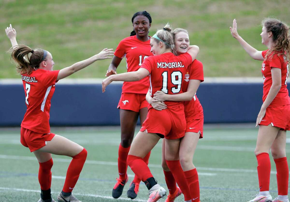 Memorial's Logan Patterson (19) is swarmed by her team mates after scoring during the first half of their Region 3 championship soccer game against Cy-Fair Friday, Apr. 9, 2021 at Tully Stadium in Houston, TX.