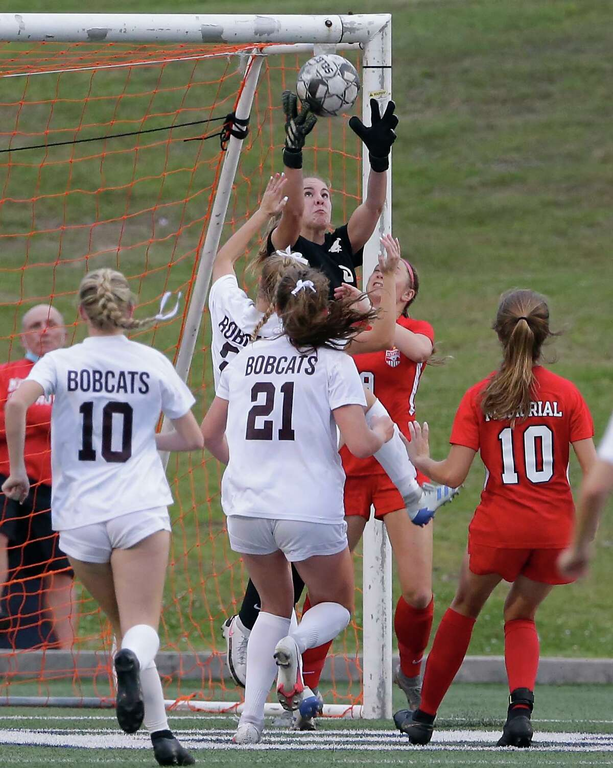 Memorial goalie Maddie Dukes jumps to catch a shot on goal during the first half of their Region 3 championship soccer game against Cy-Fair Friday, Apr. 9, 2021 at Tully Stadium in Houston, TX.