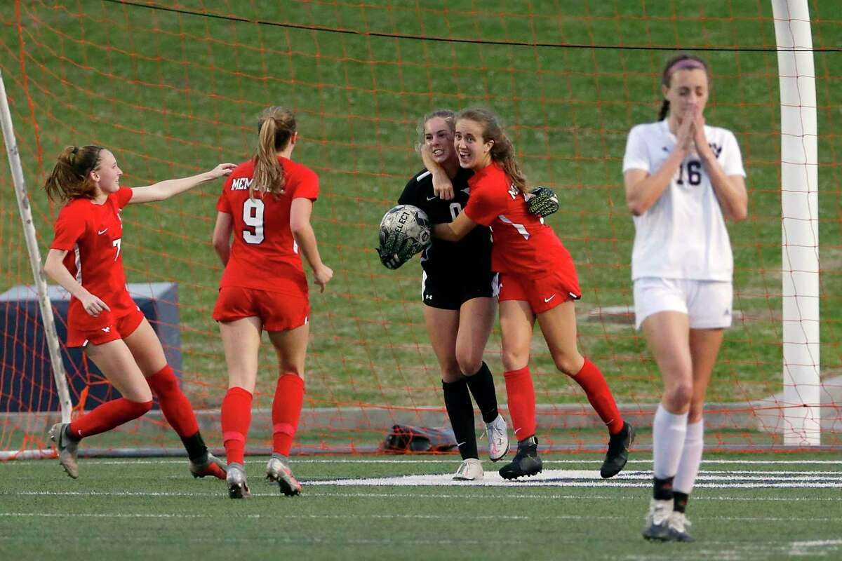 Memorial goalie Maddie Dukes (0) is swarmed by teammates after blocking the penalty kick by Cy-Fair's Marisa Dale (18) during the second half of their Region 3 championship soccer game Friday, Apr. 9, 2021 at Tully Stadium in Houston, TX.