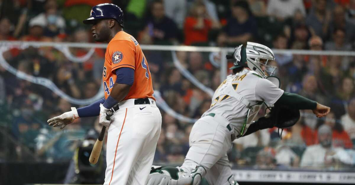 Houston Astros designated hitter Yordan Alvarez (44) reacts after striking out during the sixth inning of an MLB baseball game at Minute Maid Park, in Houston, Friday, April 9, 2021.