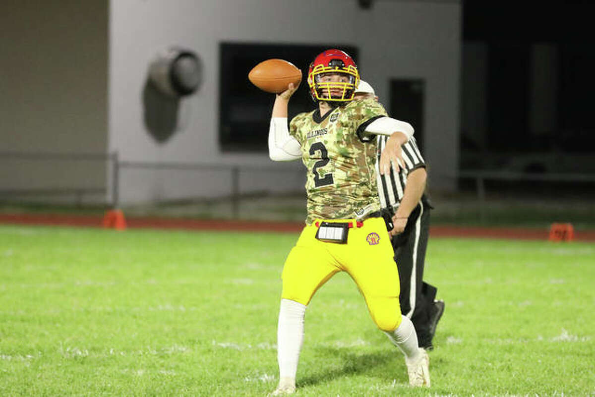 Roxana quarterback Gavin Huffman (2) passes the ball on Friday night against Staunton at Charles Raich Jr. Field.