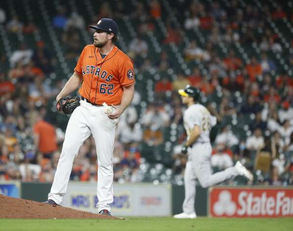 Houston Astros relief pitcher Blake Taylor (62) reacts after giving up a three-run home run to Oakland Athletics Matt Olson (28) during the eighth inning of an MLB baseball game at Minute Maid Park, in Houston, Friday, April 9, 2021. Photo: Karen Warren/Staff Photographer / @2021 Houston Chronicle