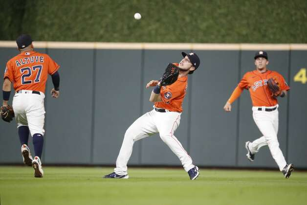 Houston Astros right fielder Kyle Tucker (30) fields Oakland Athletics Matt Chapman's fly out during the eighth inning of an MLB baseball game at Minute Maid Park, in Houston, Friday, April 9, 2021. Photo: Karen Warren/Staff Photographer / @2021 Houston Chronicle