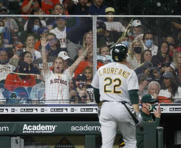 A Houston Astros fan cheers behind a sheet of plexiglass as Oakland Athletics Ramon Laureano (22) walks back to the dugout after striking out against Houston Astros relief pitcher Bryan Abreu during the eighth inning of an MLB baseball game at Minute Maid Park, in Houston, Friday, April 9, 2021. Photo: Karen Warren/Staff Photographer / @2021 Houston Chronicle