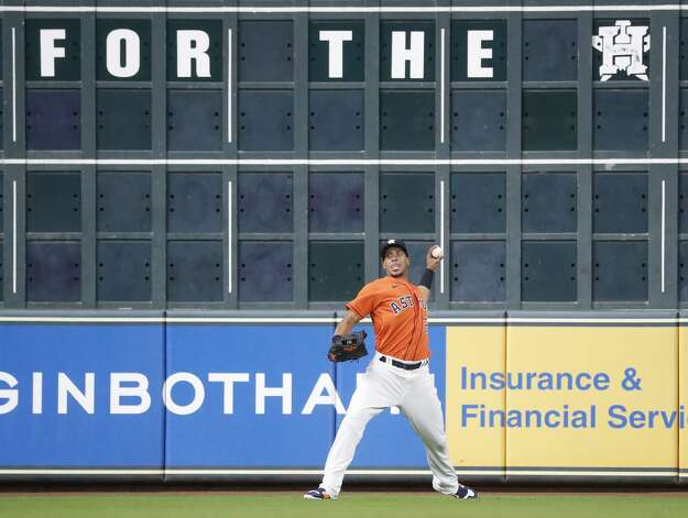 Houston Astros left fielder Michael Brantley (23) throws Oakland Athletics Jed Lowrie's sharply hit single during the eighth inning of an MLB baseball game at Minute Maid Park, in Houston, Friday, April 9, 2021. Photo: Karen Warren/Staff Photographer / @2021 Houston Chronicle