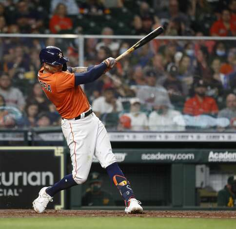 Houston Astros Carlos Correa (1) singles during the fourth inning of an MLB baseball game at Minute Maid Park, in Houston, Friday, April 9, 2021. Photo: Karen Warren/Staff Photographer / @2021 Houston Chronicle