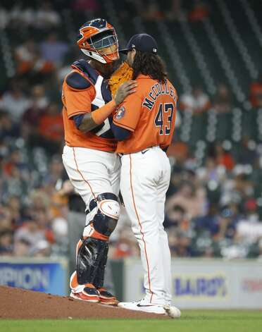 Houston Astros catcher Martin Maldonado (15) talks with starting pitcher Lance McCullers Jr. (43) during the fourth inning of an MLB baseball game at Minute Maid Park, in Houston, Friday, April 9, 2021. Photo: Karen Warren/Staff Photographer / @2021 Houston Chronicle