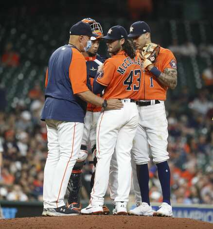 Houston Astros pitching coach Brent Strom (56) talks with Houston Astros starting pitcher Lance McCullers Jr. (43) and the infield after McCullers walked in Oakland Athletics designated hitter Seth Brown (15) during the fourth inning of an MLB baseball game at Minute Maid Park, in Houston, Friday, April 9, 2021. Photo: Karen Warren/Staff Photographer / @2021 Houston Chronicle