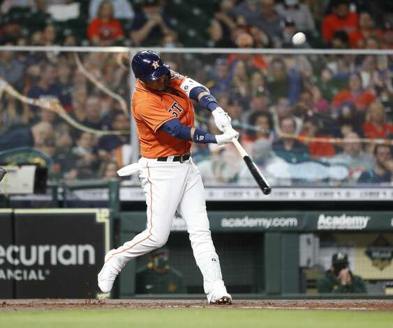 Houston Astros fYuli Gurriel (10) doubles off of Oakland Athletics starting pitcher Sean Manaea (55) during the second inning of an MLB baseball game at Minute Maid Park, in Houston, Friday, April 9, 2021. Photo: Karen Warren/Staff Photographer / @2021 Houston Chronicle