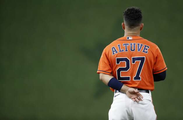 Houston Astros second baseman Jose Altuve (27) during the National Anthem before the start of the first inning of an MLB baseball game at Minute Maid Park, in Houston, Friday, April 9, 2021. Photo: Karen Warren/Staff Photographer / @2021 Houston Chronicle