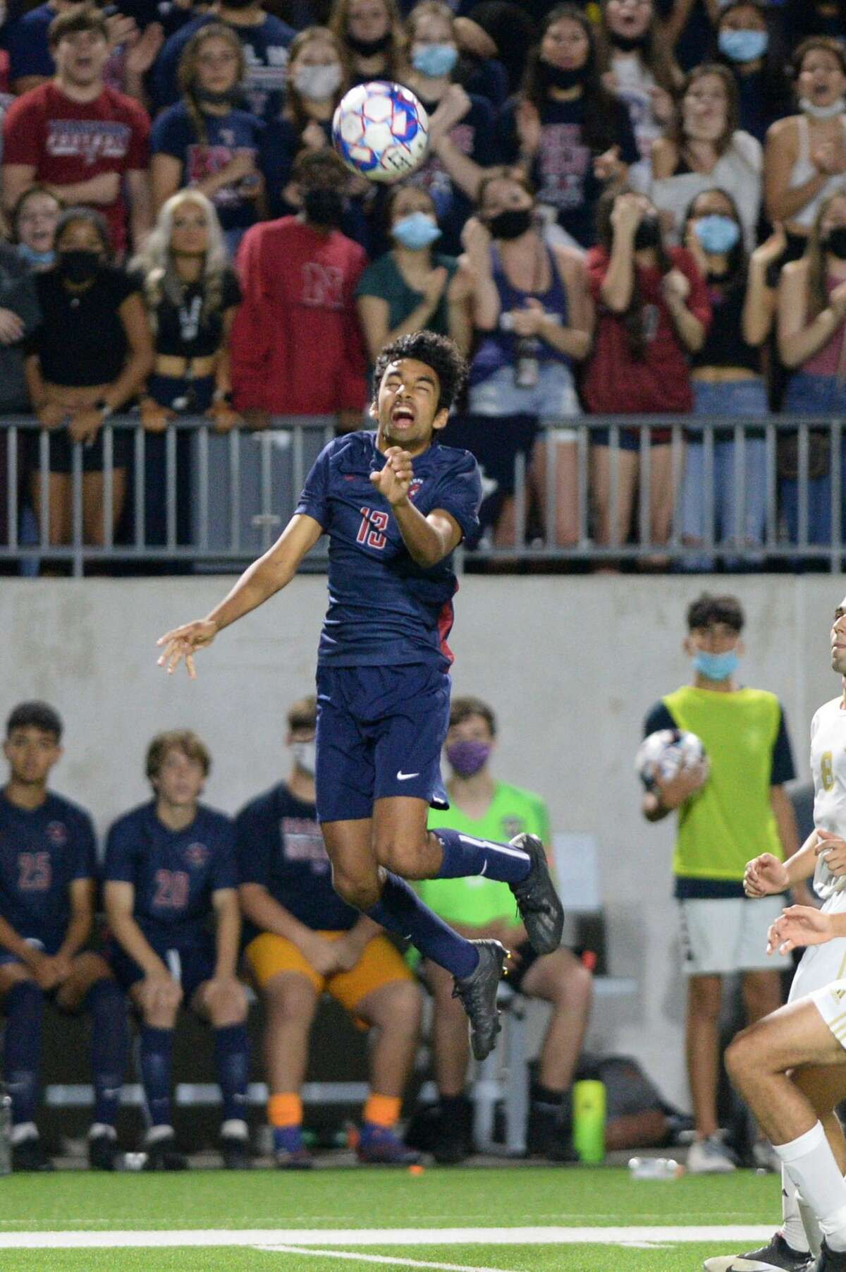 Ojas Shandilya (13) of Tompkins heads a ball during the second half of the region 6A-III soccer championship between the Tompkins Falcons and the Jersey Village Falcons on Friday, April 9, 2021 at Legacy Stadium, Katy, TX.