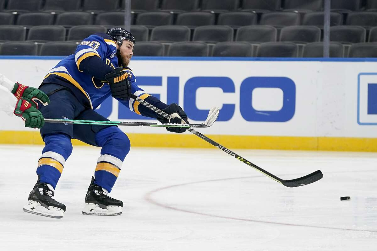 St. Louis Blues' Ryan O'Reilly scores a short-handed goal during the second period of an NHL hockey game against the Minnesota Wild Friday, April 9, 2021, in St. Louis. (AP Photo/Jeff Roberson)